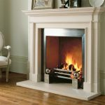 Chesneys Burlington fireplace with Soho fire basket for dogs and Spherical Steel fire dogs