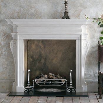 Chesneys Flaxman fireplace with the Morris fire basket for dogs and Newton andirons