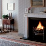Chesneys Ebury fireplace by Jane Churchill with Stanhope fire basket in steel