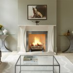 Chesneys Faulkner fireplace by Tom Faulkner with Faulkner fire dogs