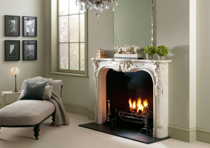 Chesneys Navarre fireplace with Morris fire basket for dogs and Burton andirons and Reeded cast iron interior panels