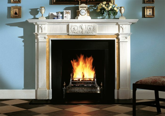 Chesneys Blenheim fireplace with the Dorchester fire basket in brass