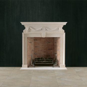 Chesneys Brettingham fireplace with the Byron fire basket for dogs, Burton Andirons and Regular brick interior panels