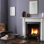 Chesneys Nash fireplace with the Byron fire basket for dogs and Telford andirons