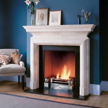 Chesneys Stirling fireplace with the Soho fire basket for dogs and Spherical Steel fire dogs