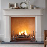 Chesneys Alhambra fireplace with the Morris fire basket for dogs and Burton andirons