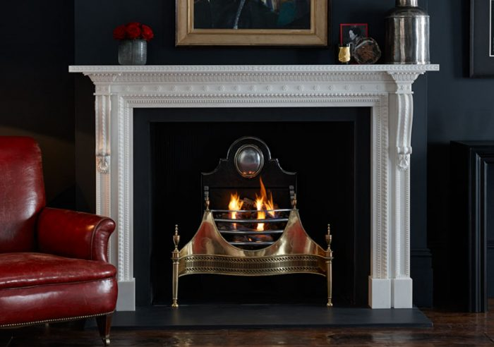 Chesneys Locke fireplace by Robert and James Adam with the Croome fire basket in brass