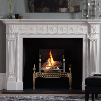 Chesneys Roxburghe fireplace by Robert and James Adam with the Osterley fire basket in brass