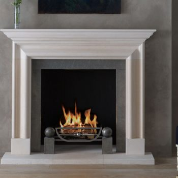 Chesneys Alderney fireplace with the Morris fire basket for dogs and Spherical Steel fire dogs