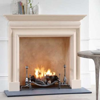 Chesneys Clandon fireplace with Burton forged steel andirons and the 22″ Swansnest fire basket for dogs