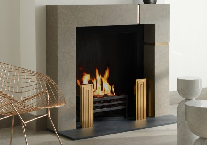 Chesneys Hugo fireplace by Kelly Hoppen with the Tom fire dogs