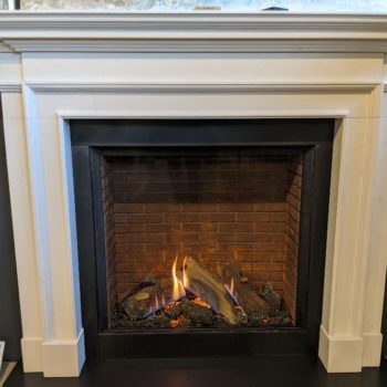 Chesneys Burlington fireplace with Stovax & Gazco Reflex 75T Edge gas fire with brick effect lining
