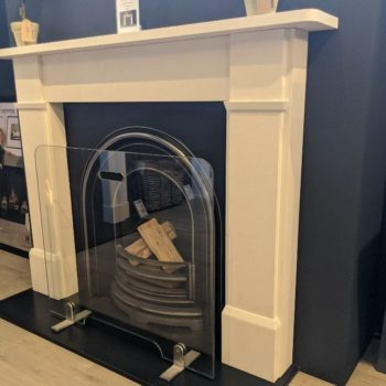 Chesneys Classic Victorian fireplace with the Britton No 4 Arched register grate in showroom