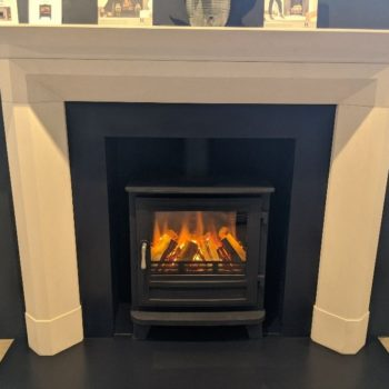 Chesneys Dylan fireplace by Kelly Hoppen with the Salisbury electric stove (large) in black in our showroom