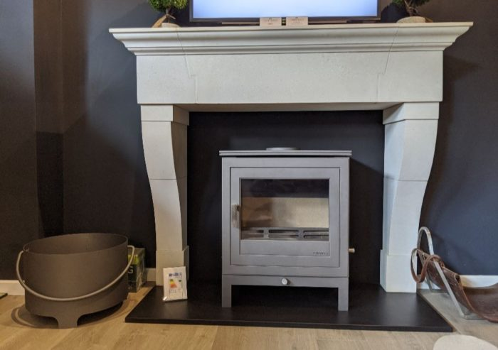 Chesneys Marseilles fireplace with the Shoreditch 8 series multi-fuel stove in silver at the showroom