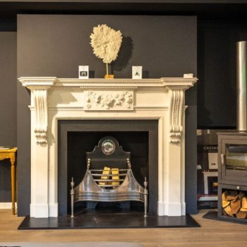 Chesneys Palladian fireplace with Croome Steel fire basket in showroom