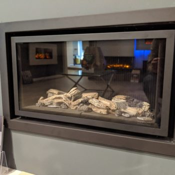 Stovax & Gazco Studio 1 gas fire Profil frame, log effect and black reeded lining in showroom