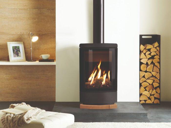Stovax & Gazco Loft gas stove with woodgrain sandstone plinth
