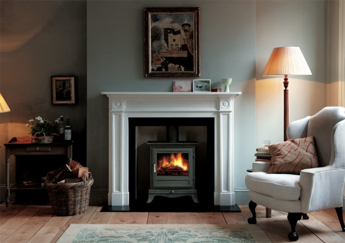 Chesneys Beaumont 8 series multi-fuel stove in Sage Green with the Langley fireplace