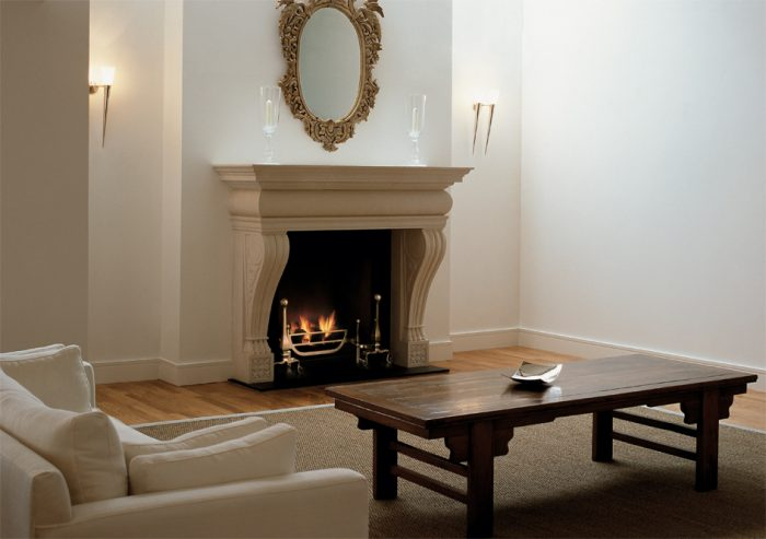 Chesneys Vicenza fireplace with the Ducksnest fire basket for dogs and Burton andirons