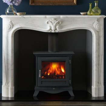 Chesneys Beaumont 5WS series wood burning stove in black anthracite with the La Rochelle fireplace