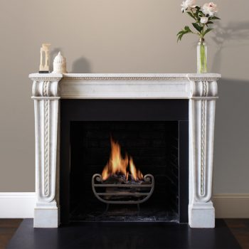 Chesneys Belvedere fireplace by Alexa Hampton with Tyndale freestanding fire basket