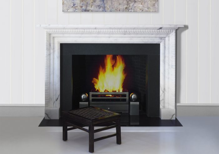 Chesneys Carlton fireplace by Alexa Hampton with Soho fire basket for dogs and Spherical Steel fire dogs