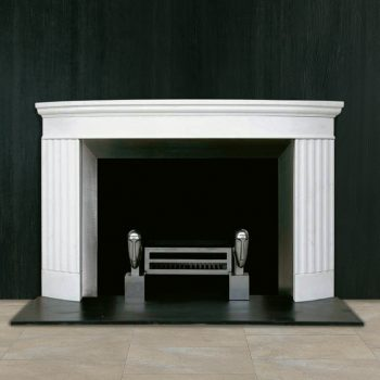 Chesneys Doric fireplace with Soho fire basket for dogs and Modi fire dogs by Caroline Ranicar