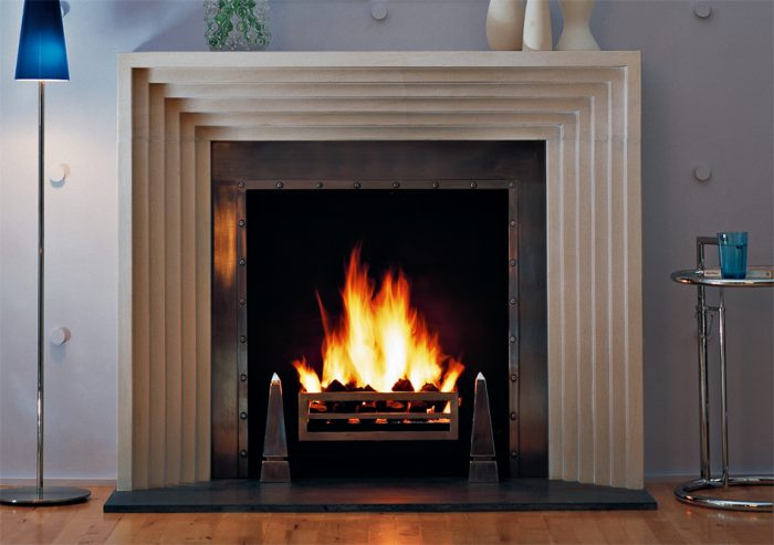 Chesneys Odeon fireplace with Soho fire basket and Obelisk fire dogs
