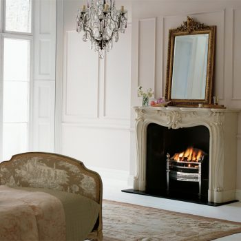 Chesneys Regence fireplace with the Cadogan fire basket in steel