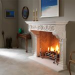 Chesneys Fiorenza fireplace with the Morris fire basket for dogs and Herringbone brick interior panels