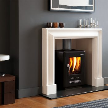 Chesneys Alpine 6 series multi-fuel stove in Black Anthracite with the Clandon Bolection Frame fireplace