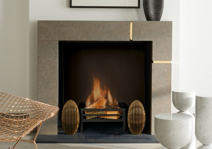 Chesneys Hugo fireplace by Kelly Hoppen with the Hunter fire dogs