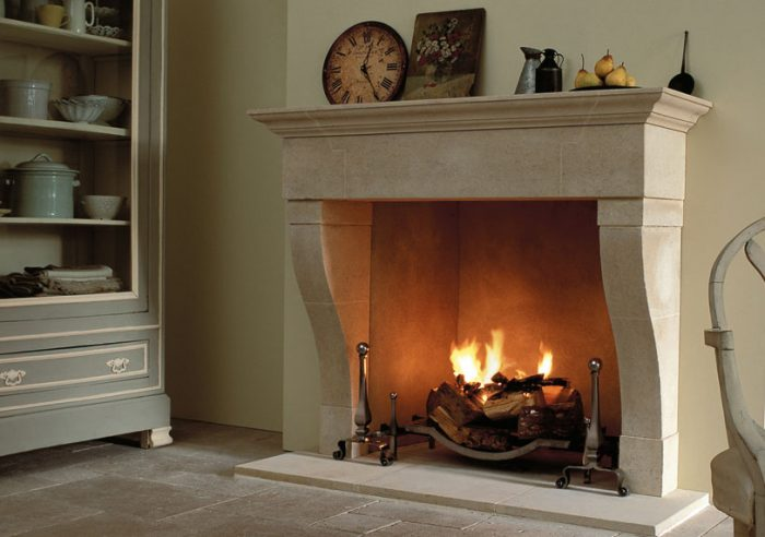 Chesneys Marseilles fireplace with the Swansnest fire basket for dogs and Burton andirons